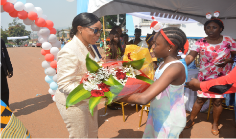 Madam the Director General in communion with the children of staff during the 2019 christmas feast